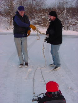 Grandpa and Daddy pull the sled to the top of the driveway