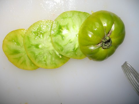 Sliced Dorothy's Green, Heirloom Tomato.  Firm, juicy, slightly sweet.